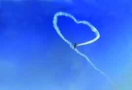 Air Show White Smoke Heart On Blue Sky