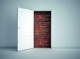 A brick wall blocking the doorway